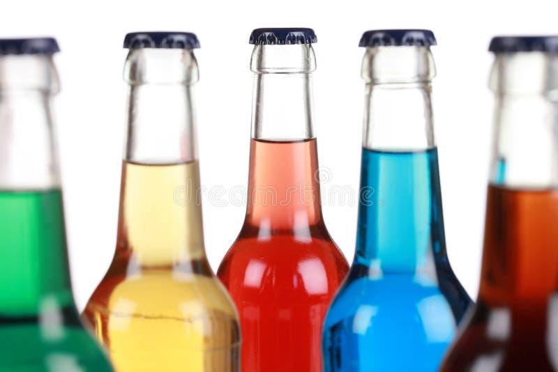 Botellas de cristal con los refrescos foto de archivo libre de regalías