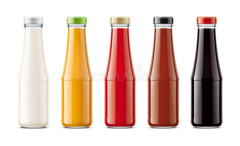 Botellas de cristal para las salsas imagenes de archivo