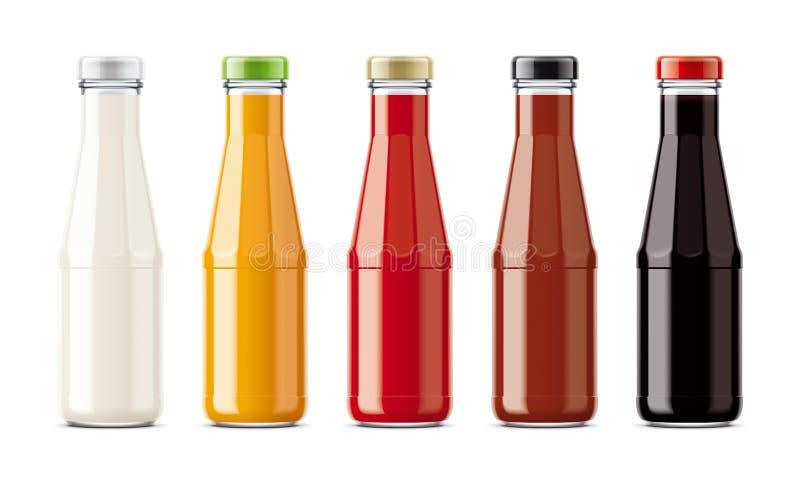 Botellas de cristal para las salsas fotos de archivo libres de regalías