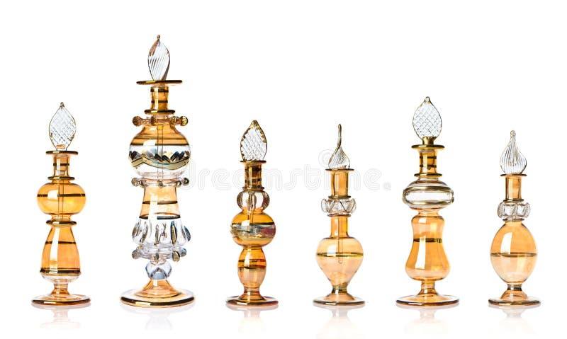 Botellas de perfume orientales de oro fotos de archivo