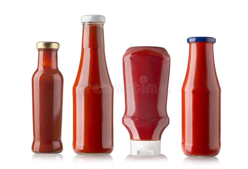 Botellas de salsa de tomate imagen de archivo
