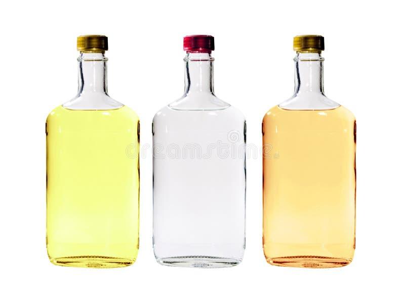 Botellas del alcohol aisladas fotos de archivo