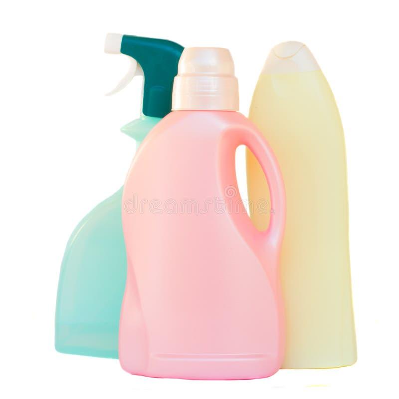 Botellas detergentes plásticas en el fondo blanco imágenes de archivo libres de regalías