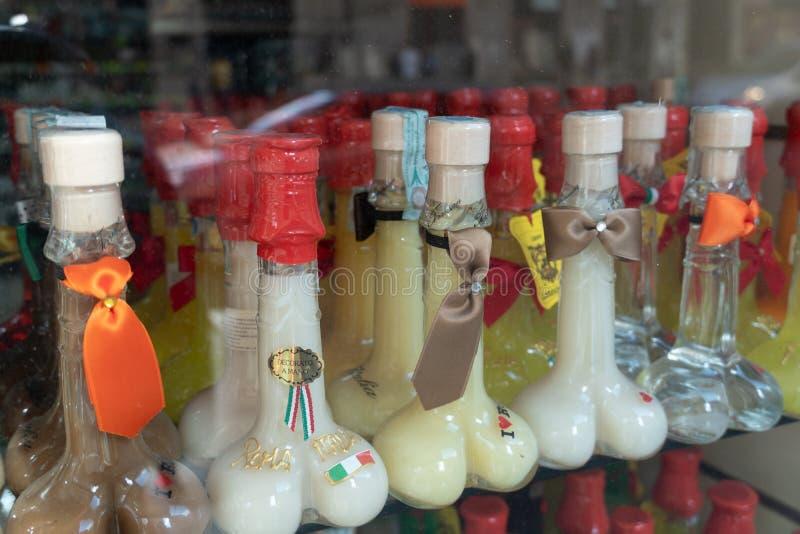 Botellas formadas pene del licor fotografía de archivo libre de regalías