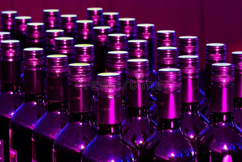 Botellas púrpuras fotos de archivo libres de regalías