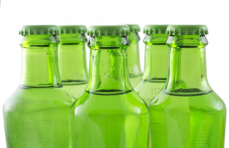 Botellas verdes de agua de soda imagen de archivo libre de regalías
