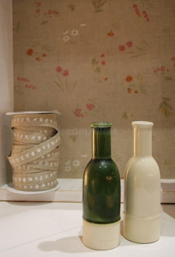 Botellas y cinta imagenes de archivo
