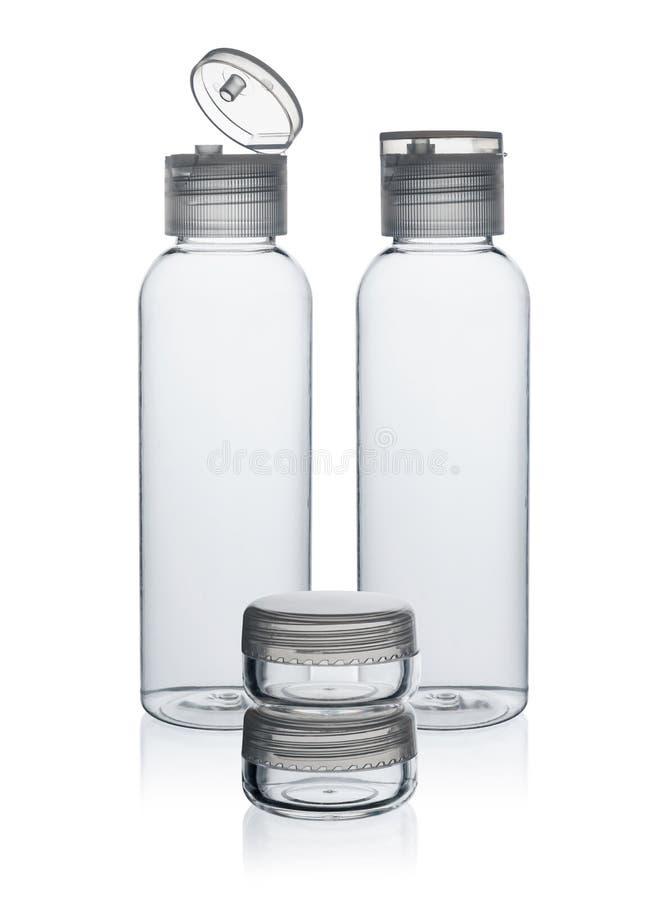 Botellas y tarro plásticos para los cosméticos fotos de archivo