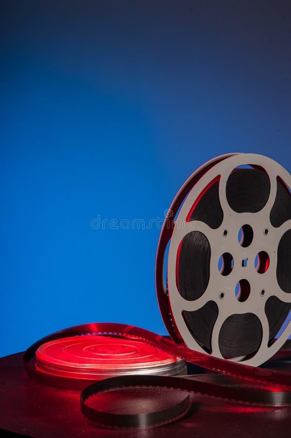 Rollo de película con la película de cine - espacio para el texto fotografía de archivo libre de regalías