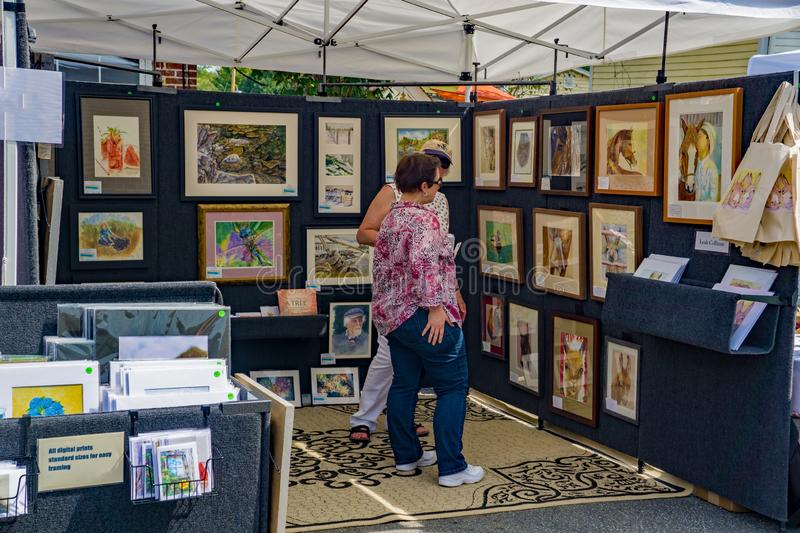 Artist`s Booth at the 50th Annual Fincastle Art and Craft Festival. Botetourt County, VA – September 21th: Artist selling prints at the 50th Annual royalty free stock images