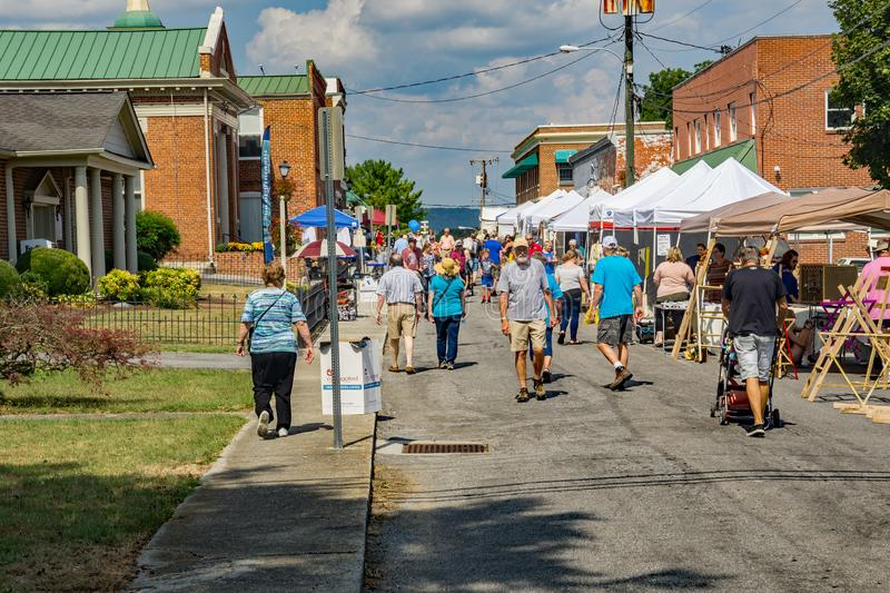 Busy Day at the 50th Annual Fincastle Art and Craft Festival. Botetourt County, VA – September 21th: Artist selling prints at the 50th Annual Fincastle royalty free stock photo