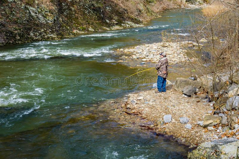 Fisherman Fishing for Trout on the Jennings Creek royalty free stock images