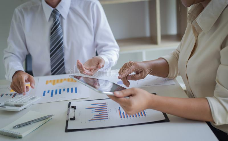 Both accountants have checked the company`s finances. Have checked the work and profit of the company In order to plan for stock photo