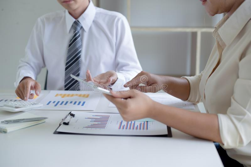 Both accountants have checked the company`s finances. Have checked the work and profit of the company In order to plan for royalty free stock photography