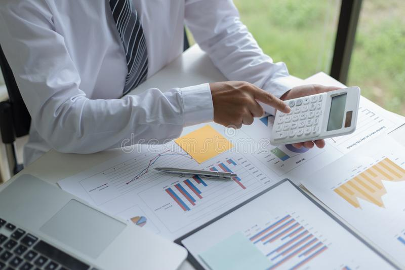 Both accountants have checked the company`s finances. Have checked the work and profit of the company In order to plan for royalty free stock photos