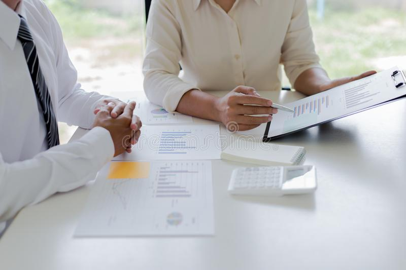 Both accountants have checked the company`s finances. Have checked the work and profit of the company In order to plan for stock images