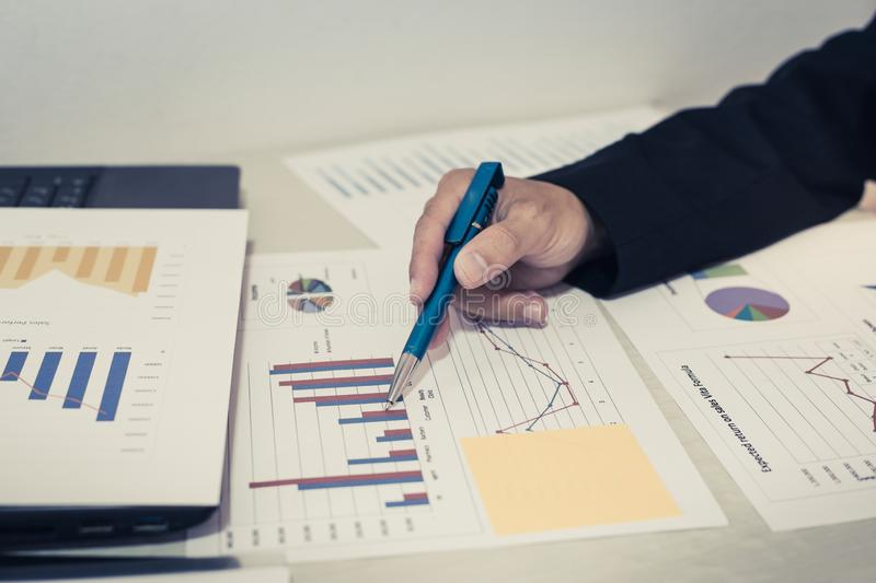 Both accountants have checked the company`s finances. Have checked the work and profit of the company In order to plan for stock photos