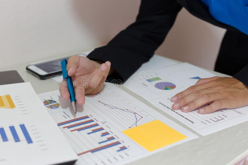 Both accountants have checked the company`s finances. Have checked the work and profit of the company In order to plan for royalty free stock photo
