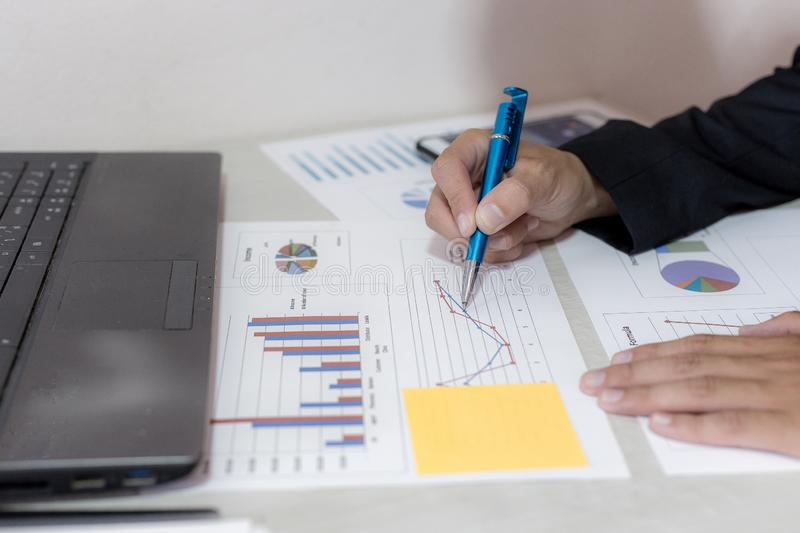 Both accountants have checked the company`s finances. Have checked the work and profit of the company In order to plan for. Business expansion to the European stock photos