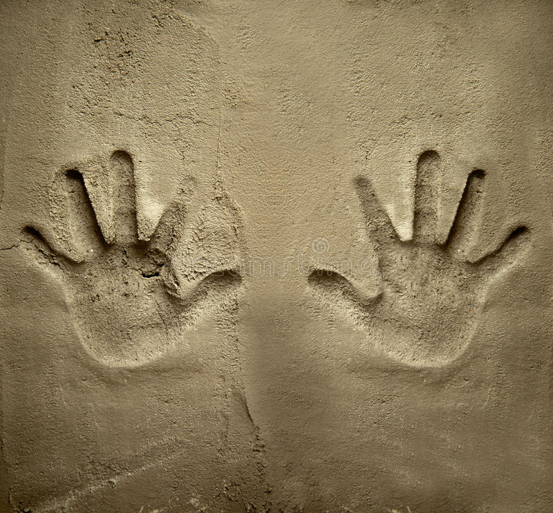 Download Both Hands Print On Cement Mortar Wall Stock Photo - Image: 24781548