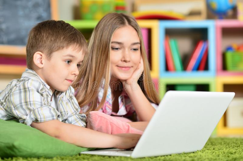Bother and sister using laptop royalty free stock photo