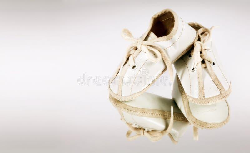 Botines del bebé foto de archivo