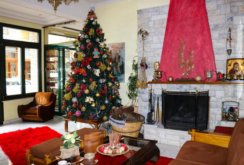 Botique hotel lobby-living room at Christmas time with tree and fireplace in Delphi Greece stock image
