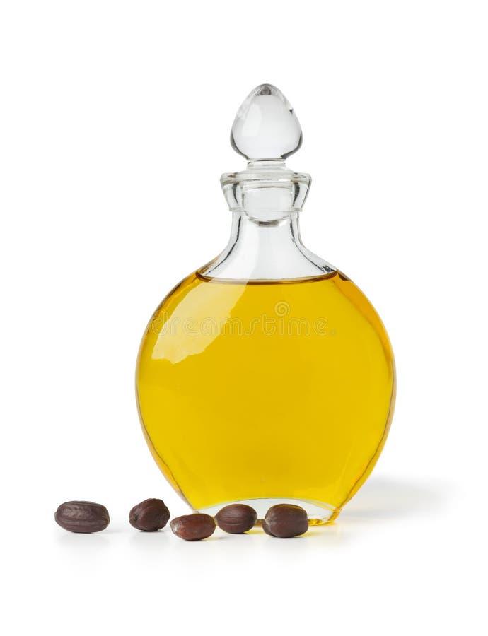 Botle d'huile et de graines de jojoba photos stock