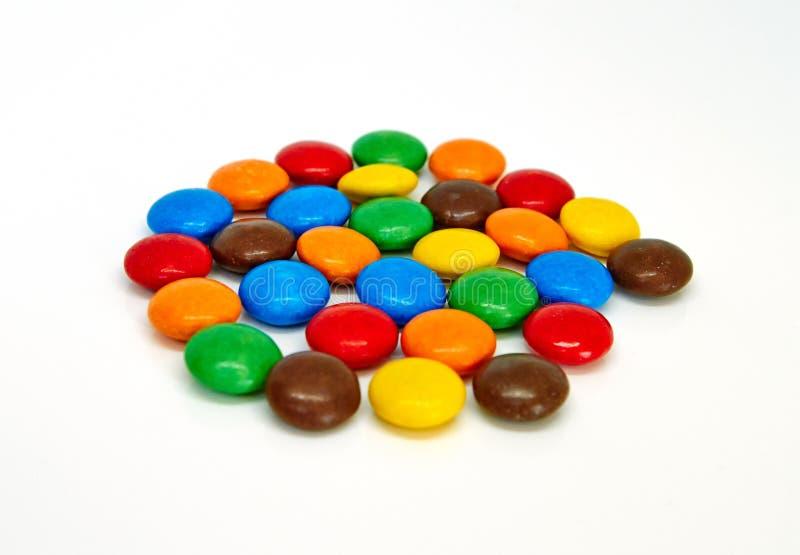 Botones coloridos del chocolate imagen de archivo