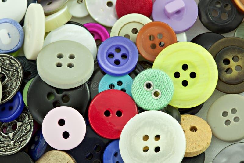 Botones coloridos para coser foto de archivo