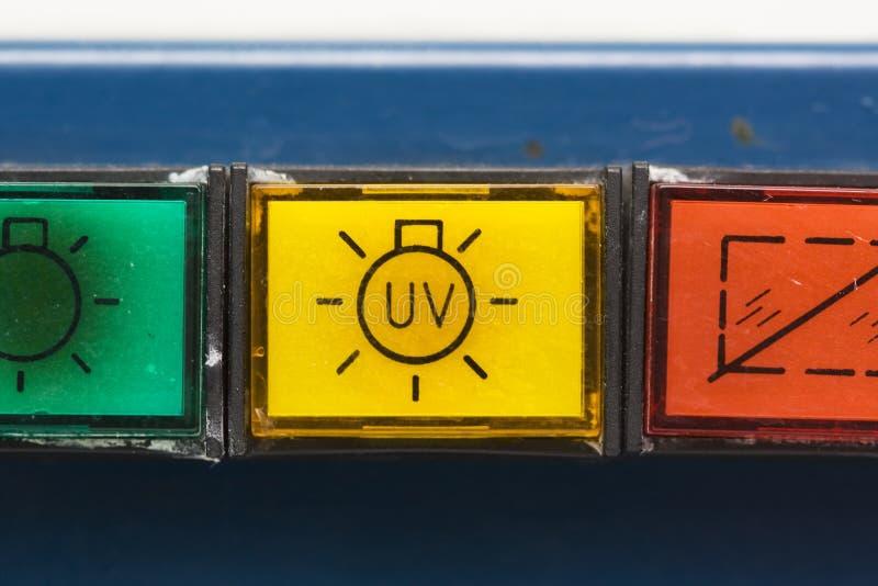 Botones en la cabina de seguridad vieja imagen de archivo