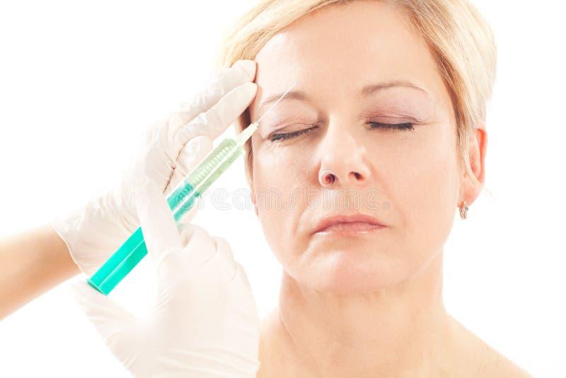 Botox - Alter und Schönheit lizenzfreies stockfoto