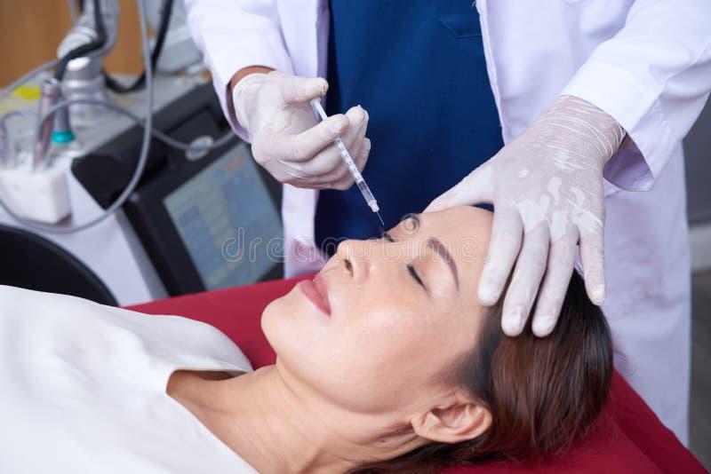 Botox Einspritzung stockbilder