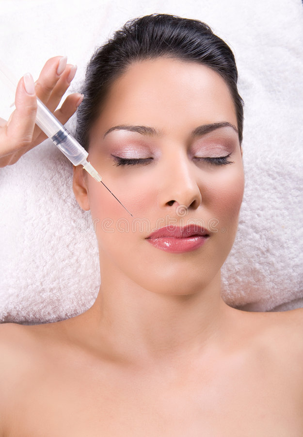 Botox injection. Beauty treatment with botox or silicone injection stock photos