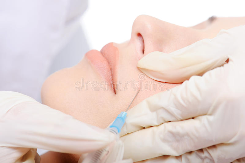 Download Botox shot in the cheek stock photo. Image of crease - 10814612