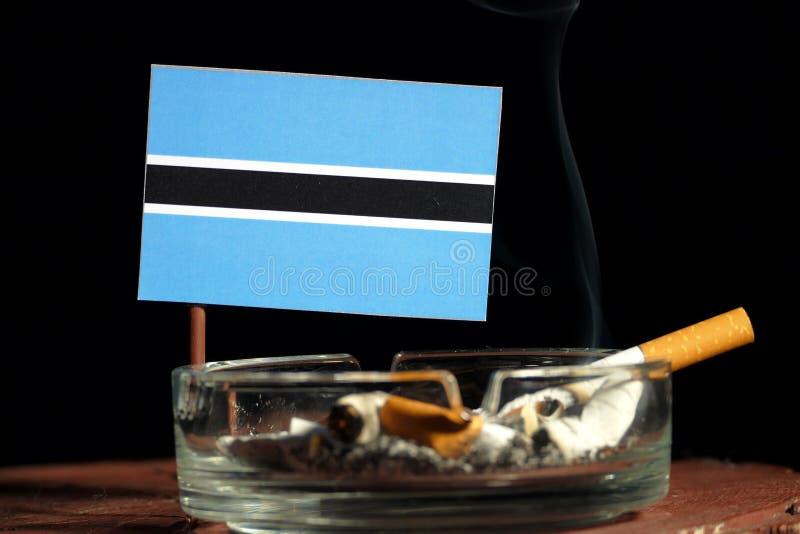 Download Botswana-Flagge Mit Brennender Zigarette Im Aschenbecher Lokalisiert Auf Schwarzem Stockfoto - Bild von nashville, getrennt: 96935156