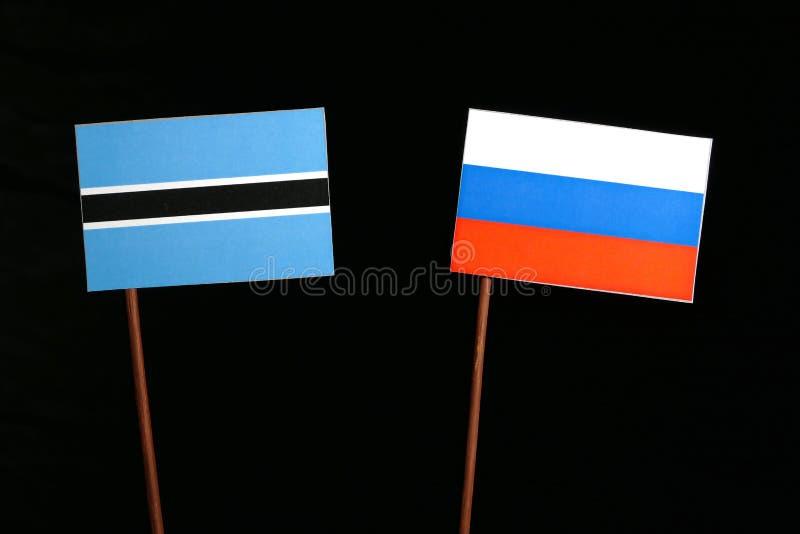 Download Botswana-Flagge Mit Der Russischen Flagge Lokalisiert Auf Schwarzem Stockbild - Bild von freundschaft, regierung: 96935251