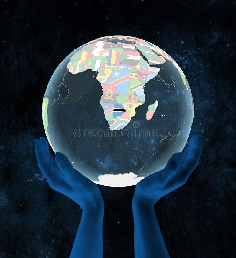 Botswana na politycznej kuli ziemskiej w rękach ilustracji