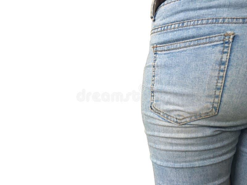 Botten för ung kvinna i ljus - jeans som isoleras på vit bakgrund arkivfoton