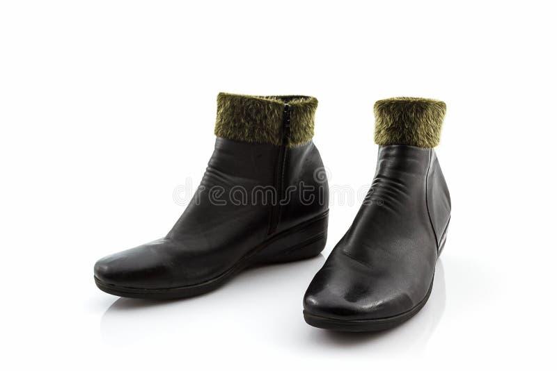 Bottes chaudes laineuses pelucheuses noires, chaussures image stock