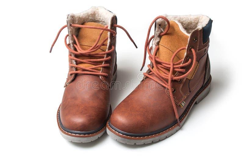 bottes d'hiver pour les hommes sur le fond blanc photographie stock