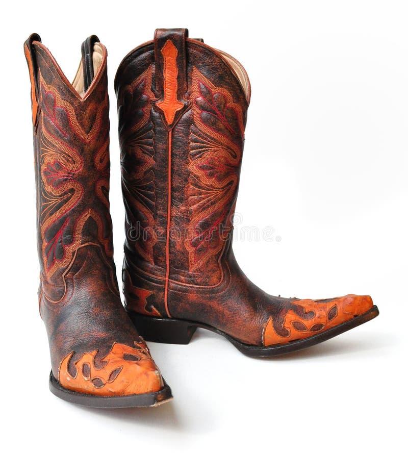 Bottes de cowboy en cuir sur le fond blanc photo stock