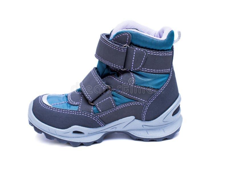 Bottes de mode d'automne ou d'hiver du ` s d'enfants d'isolement sur le fond blanc Les chaussures rouges du gosse images libres de droits