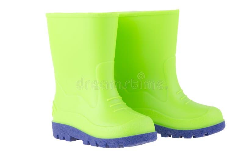 Bottes de pluie vertes d'enfants image stock