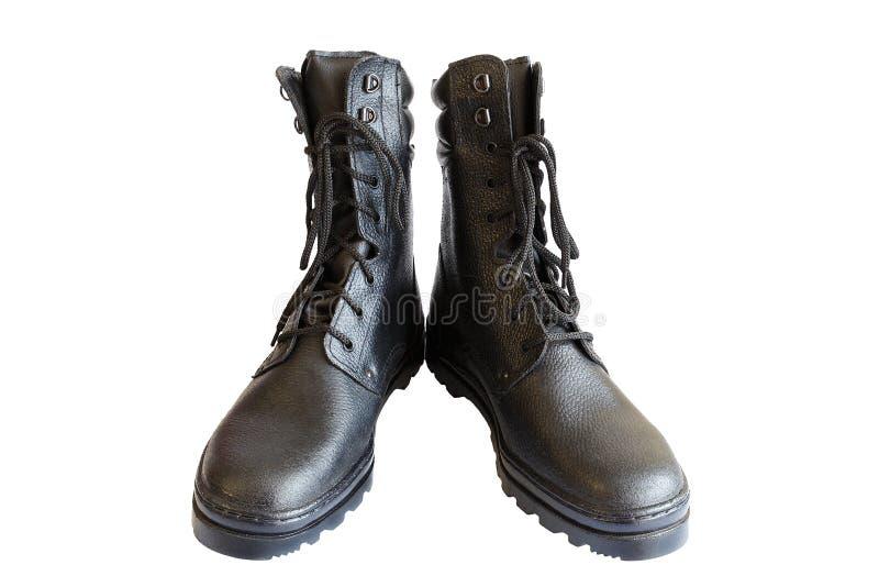 Bottes noires d'armée sur le fond blanc Chaussures sp?ciales D'isolement Une paire de bottes militaires Aucune personnes photographie stock libre de droits