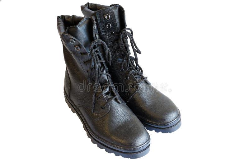 Bottes noires d'armée sur le fond blanc Chaussures sp?ciales D'isolement Une paire de bottes militaires Aucune personnes photos libres de droits