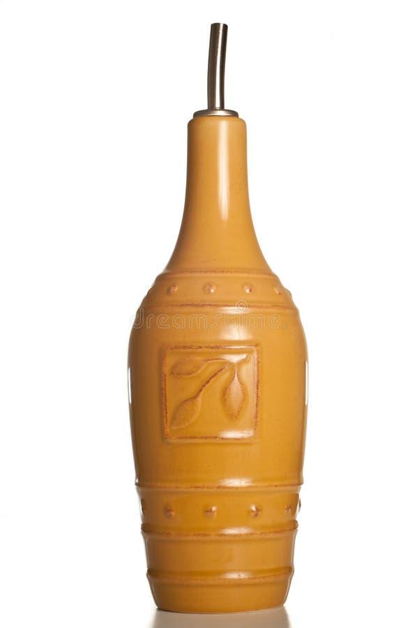Bottiglia con il becco per l'olio di oliva fotografia stock