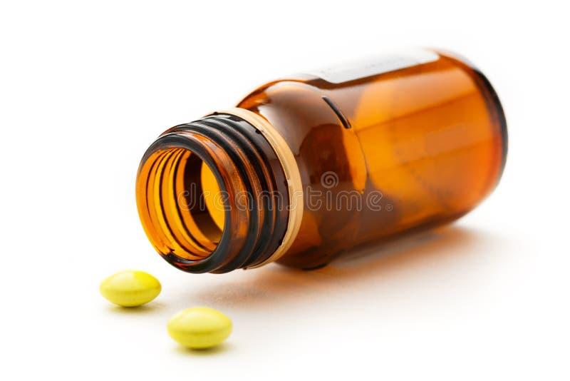 Bottiglia con le pillole in primo piano immagini stock libere da diritti