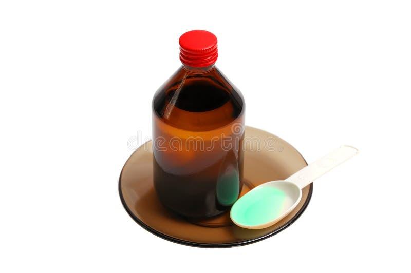 Bottiglia con una medicina e un cucchiaio immagini stock libere da diritti
