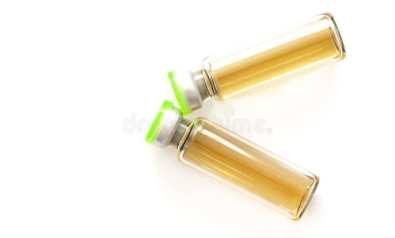 Bottiglia cosmetica delle iniezioni - botox, riempitore, collagene e soluzione acida ialuronica Cosmetologia dell'iniezione fotografia stock libera da diritti
